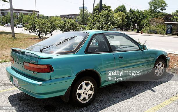 An oldermodel Acura Integra is seen in a parking lot July 19 2005 in Morton Grove Illinois Acura's Integra toped the most stolen car list of 2004