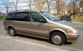 An Oldsmobile Silhouette mini van is parked on a street April 20 2001 in Boston MA General Motor Corp has announced that they are recalling more than...