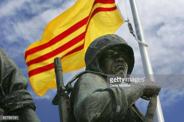 An oldstyle Vietnamese flag flies over a statue depicting a South Vietnamese soldier at the Vietnam War Memorial on April 28 2005 near the Little...
