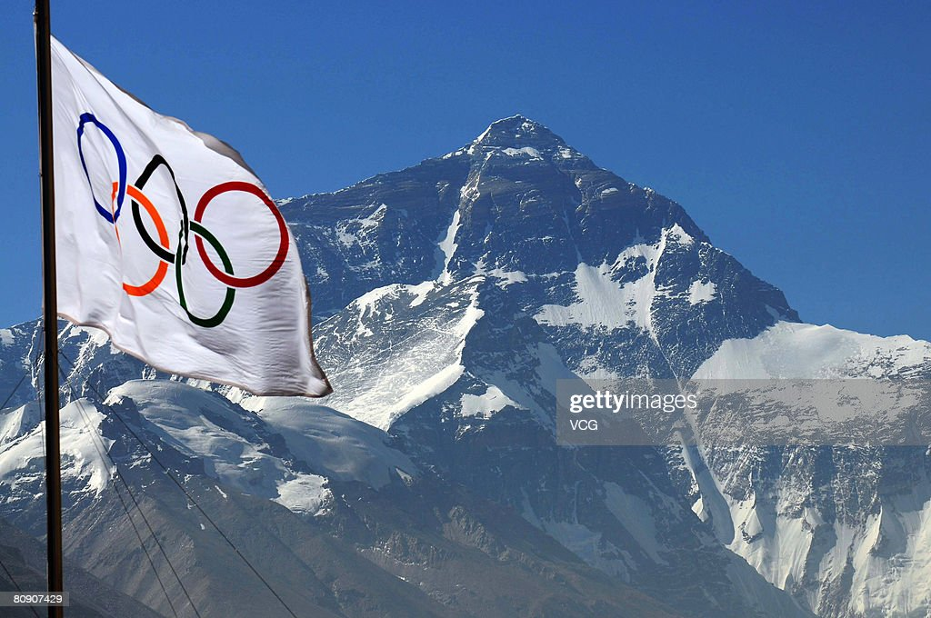 An Olympic flag waves in front of Mt. Qomolangma (Mount Everest) from the media center at the Rongbuk Base Camp as organisers prepare to cover the ascent of the Beijing Olympic flame to the world's highest peak on April 29, 2008 in Qomolangma, Tibet. The torch bearers are waiting for some good weather before they start the relay.