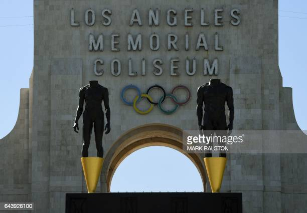 An Olympic themed monument stands at the Los Angeles Memorial Coliseum after rival Budapest dropped its bid for the 2024 Olympics in Los Angeles...
