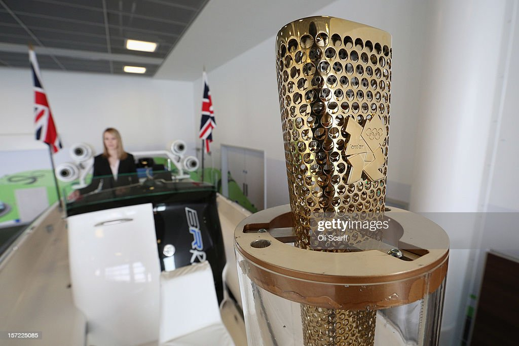 An Olympic torch on a Bladerunner RIB 35 Powerboat in Mercedes-Benz World on November 30, 2012 in Weybridge, England. The boat was driven by footballer David Beckham as it carried the Olympic flame to the Olympic Stadium in the opening ceremony of the London 2012 Olympic Games. The boat is due to be auctioned on December 3, 2012 and is expected to fetch 250,000 GBP.