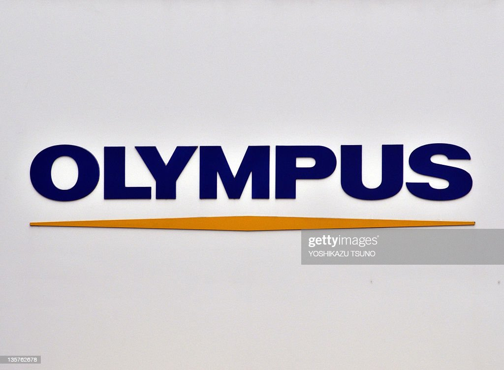 An Olympus logo is displayed at the company's showroom in Tokyo on December 14, 2011. Scandal-hit Olympus on December 14 filed corrected earnings reports for the past five fiscal years as the company grapples with an accounting scandal that has tainted Japanese corporate governance. AFP PHOTO / Yoshikazu TSUNO
