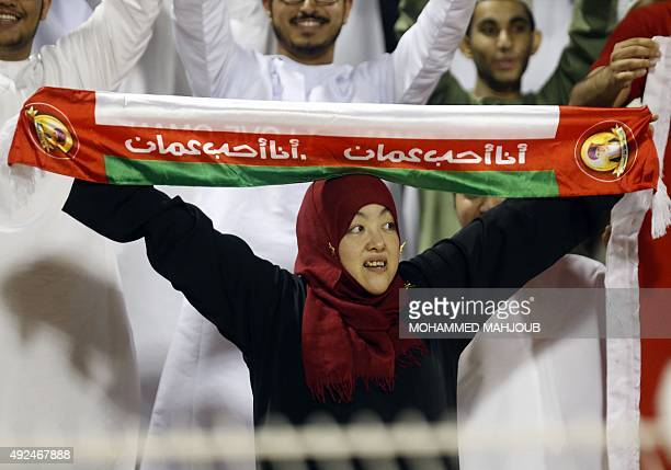An Omani fan cheers on her team during the AFC qualifying football match for the 2018 FIFA World Cup between Oman and India on October 13 2015 at the...