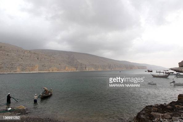 An Omani fisherman pulls in his net at a small harbor in Khasab area of Oman along the Strait of Hormuz on January 14 2011 Iran has responded to...