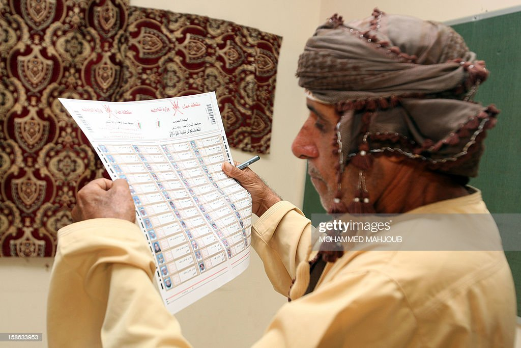 An Omani man chooses his candidates at a polling station in Shinas district, on December 22, 2012. Omanis went to the polls for the Gulf sultanate's first ever local elections but the 192 elected councillors will have only advisory powers. AFP PHOTO / MOHAMMED MAHJOUB