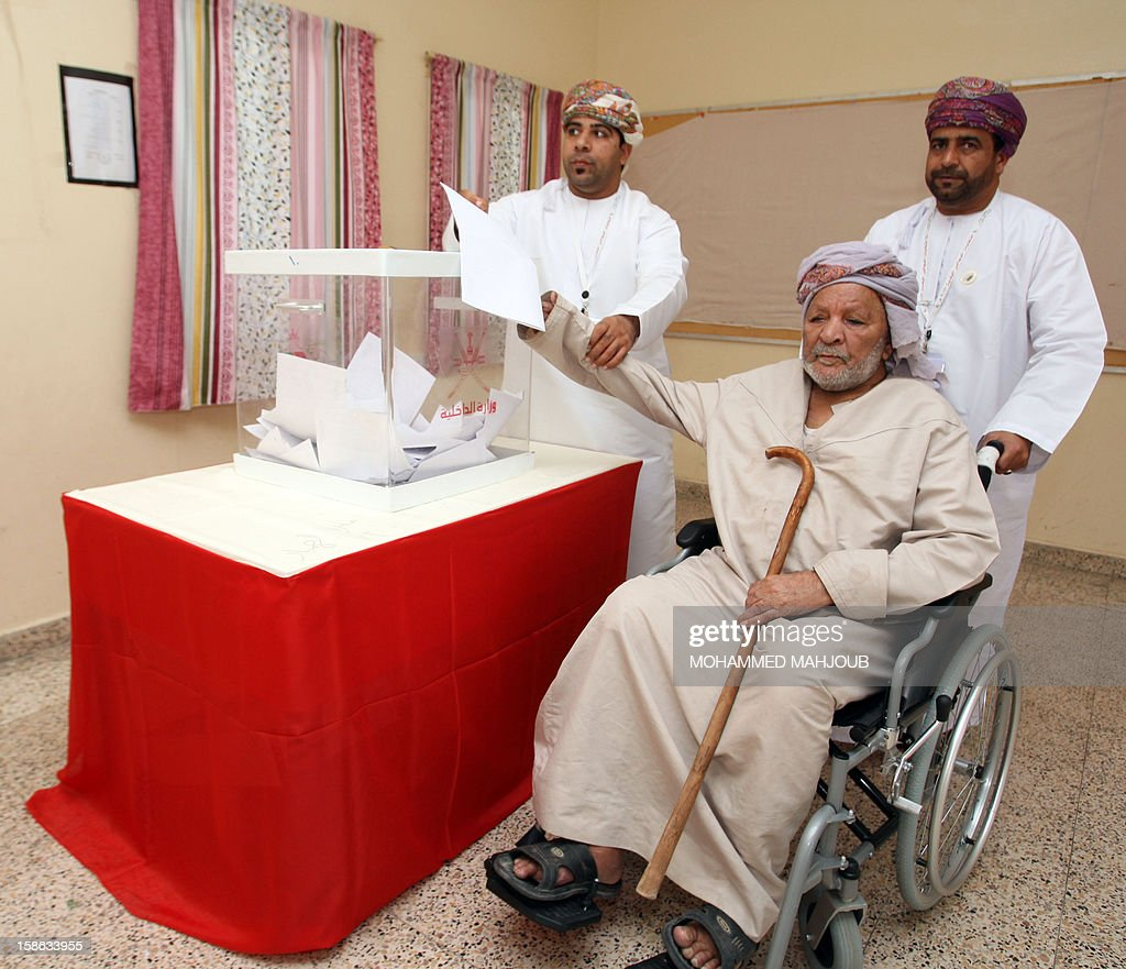 An Omani man is aided as he casts his vote at a polling station in the Sohar district, on December 22, 2012. Omanis went to the polls for the Gulf sultanate's first ever local elections but the 192 elected councillors will have only advisory powers.