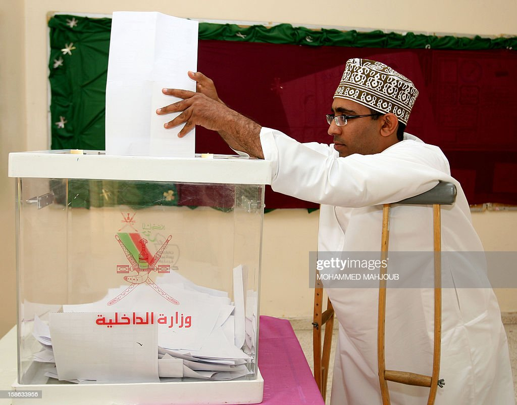 An Omani man is aided as he casts his vote at a polling station in the Saham district, on December 22, 2012. Omanis went to the polls for the Gulf sultanate's first ever local elections but the 192 elected councillors will have only advisory powers.