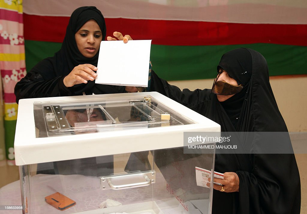 An Omani woman casts her vote at a polling station in the al-Khaburah district, on December 22, 2012. Omanis went to the polls for the Gulf sultanate's first ever local elections but the 192 elected councillors will have only advisory powers.