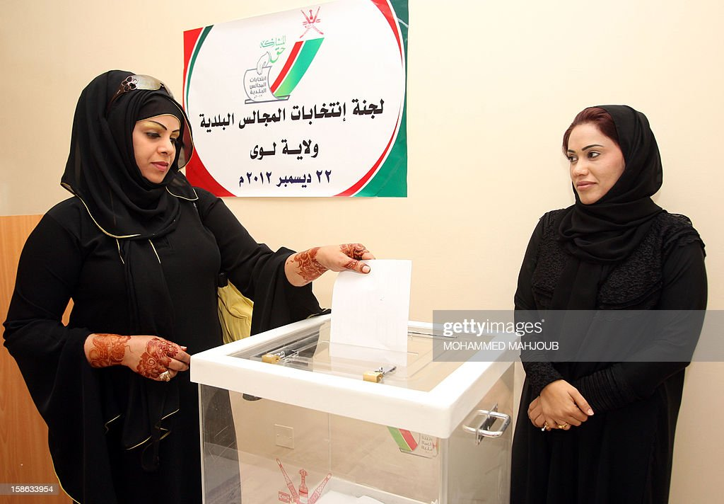 An Omani woman casts her vote at a polling station in the al-Liwa district, on December 22, 2012. Omanis went to the polls for the Gulf sultanate's first ever local elections but the 192 elected councillors will have only advisory powers.
