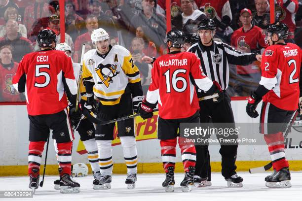 An on ice official separates Dion Phaneuf Clarke MacArthur and Cody Ceci of the Ottawa Senators from Evgeni Malkin of the Pittsburgh Penguins in Game...