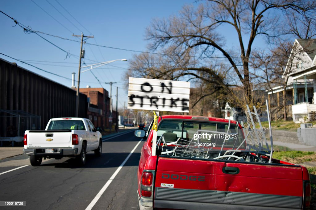 An 'on strike' sign stands on the truck of striking worker Arthur King, who said he has been sleeping in his truck on the picket line for a week, outside a Hostess Brands Inc. bakery in Peoria, Illinois, U.S., on Friday, Nov. 16, 2012. Hostess Brands Inc., the bankrupt maker of Wonder bread and Twinkies, said it will fire more than 18,000 workers and liquidate after a nationwide strike by bakery workers crippled operations. Photographer: Daniel Acker/Bloomberg via Getty Images