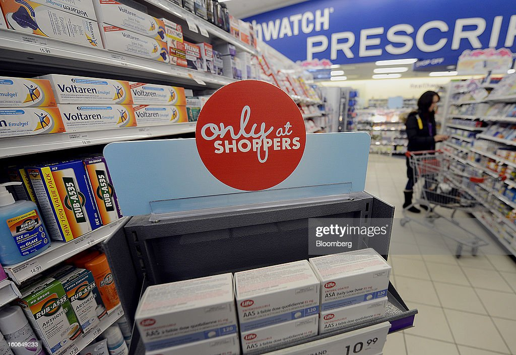 An 'Only at Shoppers' sign is displayed as a customer browses at a Shoppers Drug Mart Corp. store in Toronto, Ontario, Canada, on Monday, Feb. 4, 2013. Shoppers Drug Mart Corp., Canada's largest pharmacy chain, is scheduled to release earnings data on Feb. 7. Photographer: Aaron Harris/Bloomberg via Getty Images