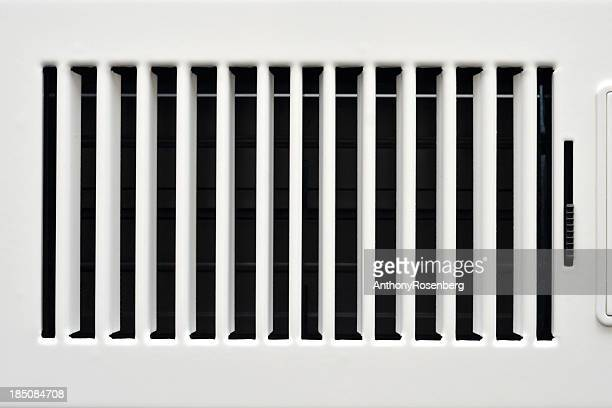 An opaque white heating vent opened