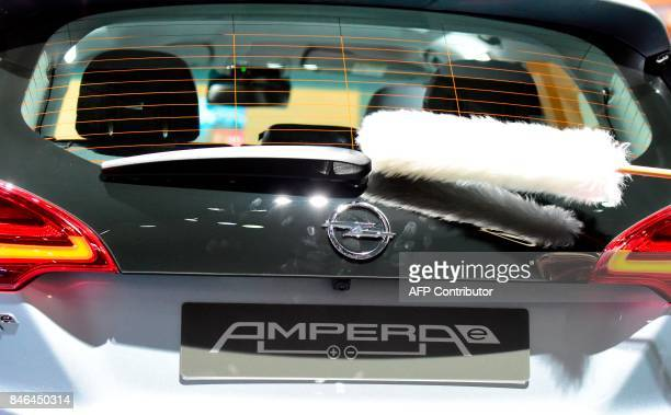 An Opel Amperae electric car is cleaned at the Frankfurt Auto Show IAA in Frankfurt am Main Germany on September 13 2017 According to organisers...