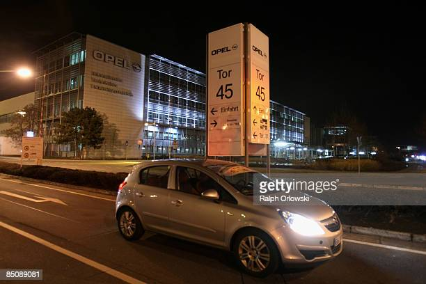 An Opel Astra car stands in front of the factory of carmaker Opel on February 25 2009 in Ruesselsheim Germany Despite the top results of Germanbased...