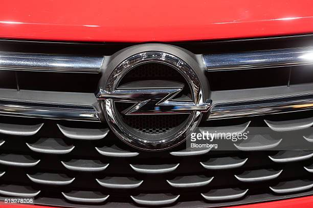 An Opel badge sits on the grille of an Opel Astra automobile produced by General Motors Co sits on display on the second day of the 86th Geneva...