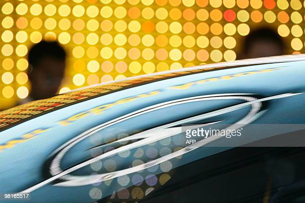 An Opel Logo is reflected on the top of a car during a press conference on March 2 2010 during the second press day at the 80th Geneva International...