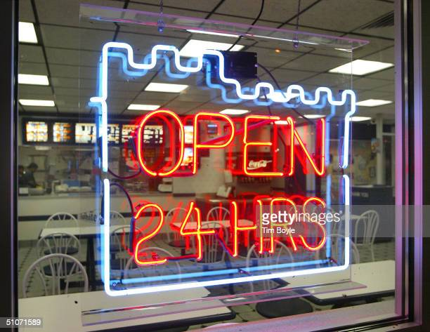An 'Open 24 HRS' sign is displayed in a window of a White Castle fastfood restaurant July 15 2004 in Des Plaines Illinois Fastfood restaurant chains...