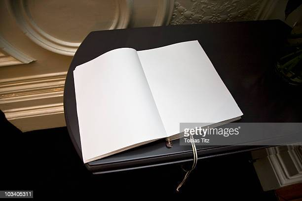 An open blank guest book