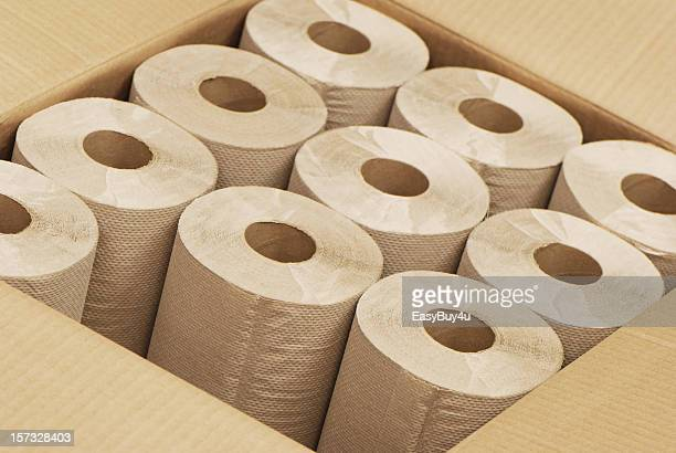 An open brown box of rolls of paper towels