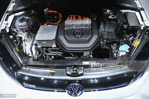 An open hood reveals the motor of a Volkswagen eGolf electric car prior to the company's annual press conference to announce financial results for...
