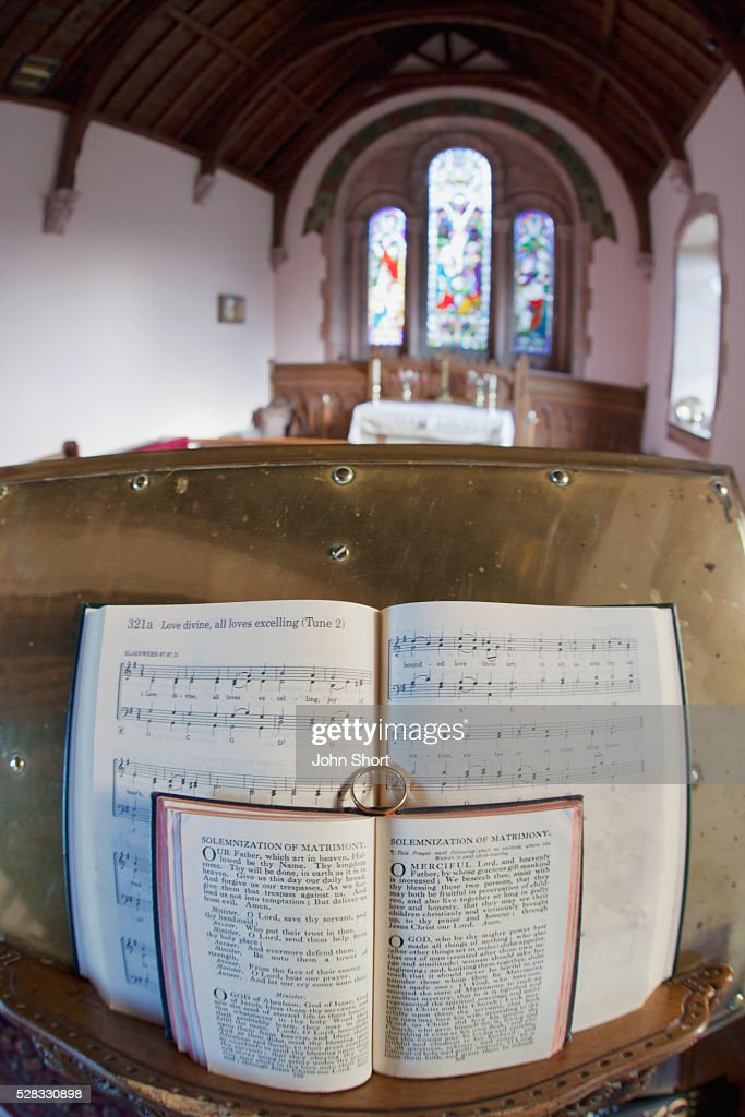 An Open Hymnal And Bible On A Podium Inside A Church; Northumberland England