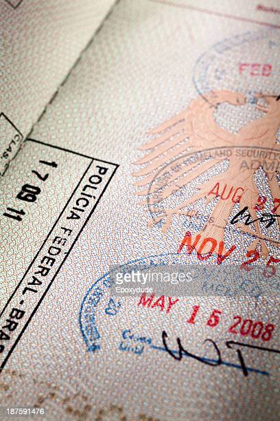 An open passport with several entrance stamps on the pages