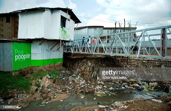 An open sewer flows on June 8 2012 at Kibera slum in Nairobi where poor sanitation is endemic and threatens the lives of the local community A cheap...