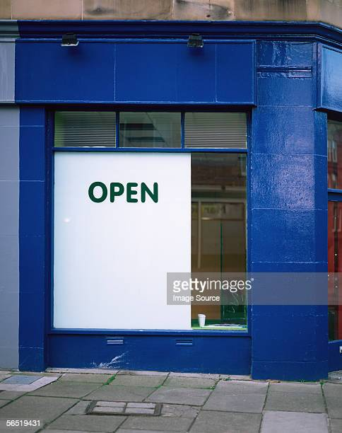 An open sign in a shop