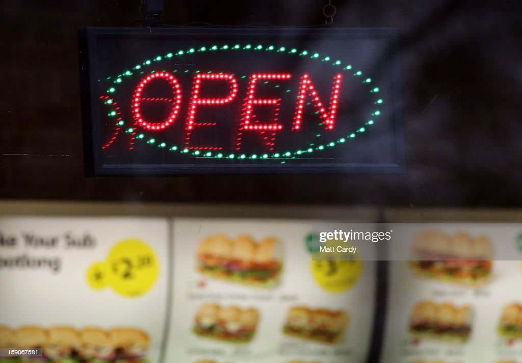 An open sign outside a branch of a takeaway chain on January 7, 2013 in Bristol, England. A government-backed TV advert - made by Aardman, the creators of Wallace and Gromit - to promote healthy eating in England, is to be shown for the first time later today. England has one of the highest rates of obesity in Europe - costing the NHS 5 billion GDP each year - with currently over 60 percent of adults and a third of 10 and 11 year olds thought to be overweight or obese.