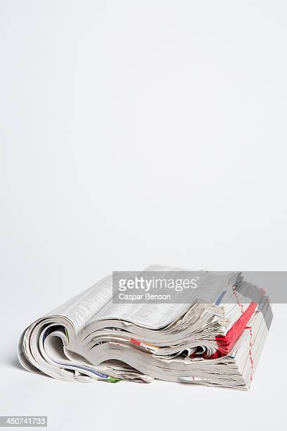 An open well-used white pages telephone book