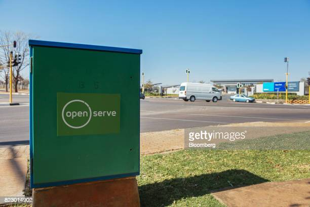 An Openserve logo sits on a 'green box' internet connectivity unit on a sidewalk near the Telkom SA SOC Ltd head office in the Centurion district of...