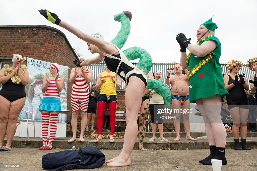 An openwater swimmer dressed as the Loch Ness Monster poses after winning the fancy dress competition before taking part in the annual December Dip...