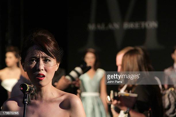 An opera singer performs during the Malan Breton show during Spring 2014 MercedesBenz Fashion Week at The Box at Lincoln Center on September 7 2013...