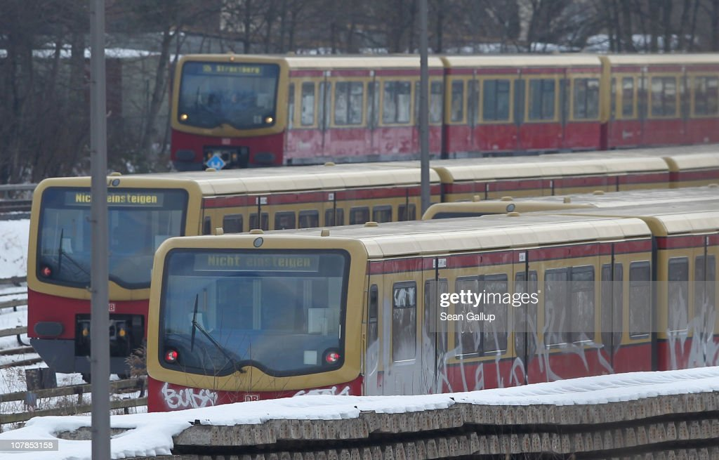 An operational train (above) of the Berlin S-Bahn commuter rail network passes by two idle trains near an S-Bahn maintenance facility on January 3, 2011 in Berlin, Germany. According to media reports out of the S-Bahn's 1,100 train cars only 426 are in service. The others, according to S-Bahn officials, are in repair due to damage caused by the early and harsh winter weather this year. The shortfall in operating trains has led to longer waits for commuters and, in some cases, cancelled service to outlying districts altogether. The Berlin S-Bahn, a subsidiary of the German state rail carrier Deutsche Bahn, has been unable to keep its full fleet of trains operational for the last two years, and critics charge the shortfalls are due to inadequate investment in facilities and personnel.