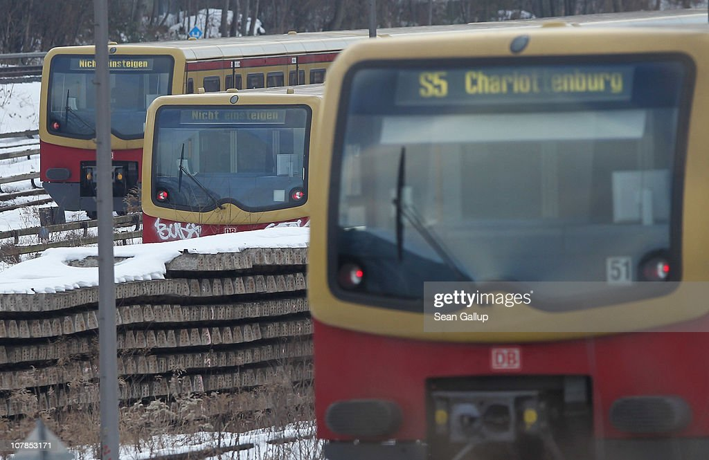 An operational train (R) of the Berlin S-Bahn commuter rail network passes by two idle trains near an S-Bahn maintenance facility on January 3, 2011 in Berlin, Germany. According to media reports out of the S-Bahn's 1,100 train cars only 426 are in service. The others, according to S-Bahn officials, are in repair due to damage caused by the early and harsh winter weather this year. The shortfall in operating trains has led to longer waits for commuters and, in some cases, cancelled service to outlying districts altogether. The Berlin S-Bahn, a subsidiary of the German state rail carrier Deutsche Bahn, has been unable to keep its full fleet of trains operational for the last two years, and critics charge the shortfalls are due to inadequate investment in facilities and personnel.