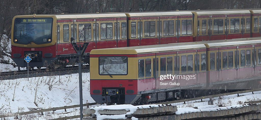 An operational train (above) of the Berlin S-Bahn commuter rail network passes by an idle train near an S-Bahn maintenance facility on January 3, 2011 in Berlin, Germany. According to media reports out of the S-Bahn's 1,100 train cars only 426 are in service. The others, according to S-Bahn officials, are in repair due to damage caused by the early and harsh winter weather this year. The shortfall in operating trains has led to longer waits for commuters and, in some cases, cancelled service to outlying districts altogether. The Berlin S-Bahn, a subsidiary of the German state rail carrier Deutsche Bahn, has been unable to keep its full fleet of trains operational for the last two years, and critics charge the shortfalls are due to inadequate investment in facilities and personnel.