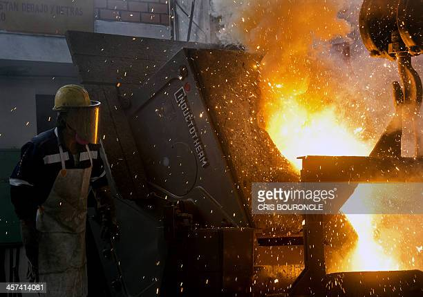 An operator at a foundry in Lima works in the melting of 3500 diverse firearms seized from criminal acts disarmament and amnesty programs on December...