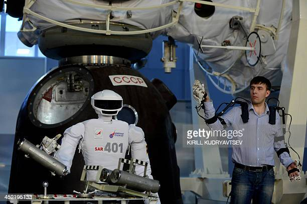An operator demonstrates SAR401 advanced anthropomorphic robot at the Gagarin Cosmonauts' Training Centre in Star City centre outside Moscow on...