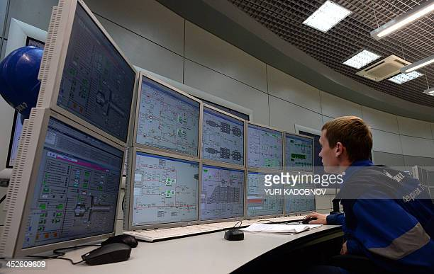 An operator looks at the screens in the control centre of the recently built Adler thermal power plant in the Russian Black Sea resort of Sochi on...