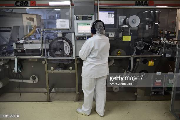 An operator monitors the packaging chain of tablets in the premises of the French pharmaceutical company Servier in Gidy some 100 km south of Paris...