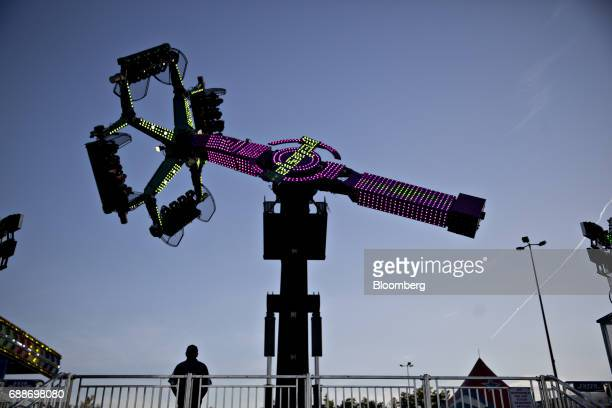 An operator watches as the Delusion ride operates during the Dreamland Amusements carnival in the parking lot of the Marley Station Mall in Glen...