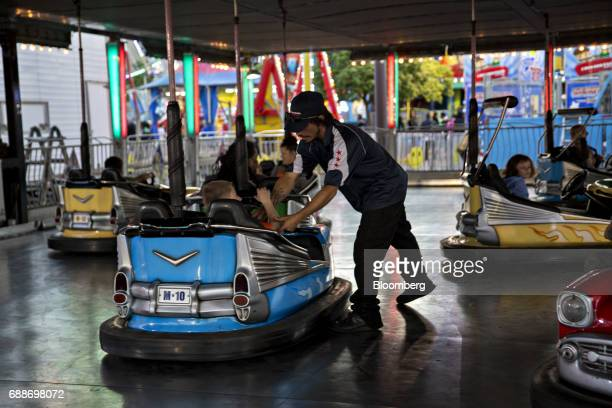 An operator works the bumper cars ride during the Dreamland Amusements carnival in the parking lot of the Marley Station Mall in Glen Burnie Maryland...