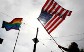 An opponent of Prop 8 holds waves an American flag during a rally to celebrate the ruling to overturn Prop 8 August 4 2010 in San Francisco...