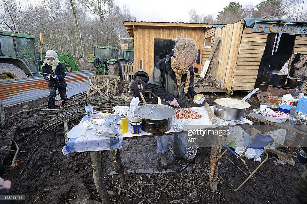 An opponent to an international airport project is at work near shacks within the ZAD ('Zone d'Aménagement Différé') a zone reserved for the later development of the project, on December 11, 2012 in Notre-Dame-des-Landes, western France. The vast stretch of woodland outside the tiny village of Notre-Dame-des-Landes is now Europe's biggest open air squat, according to the local police chief.