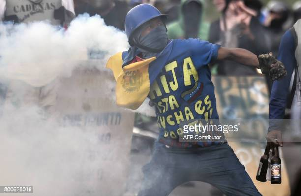 An opposition activist clashes with the police at the Francisco de Miranda air force base during a demonstration against the government of Venezuelan...
