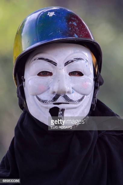 An opposition activist wears a mask during a demonstration against President Nicolas Maduro's government in Caracas on May 29 2017 Demonstrations...