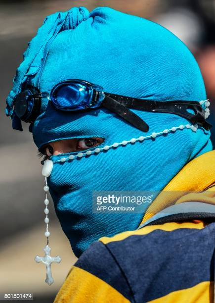 TOPSHOT An opposition demonstrator during a protest in Caracas on June 26 2017 A political and economic crisis in the oilproducing country has...