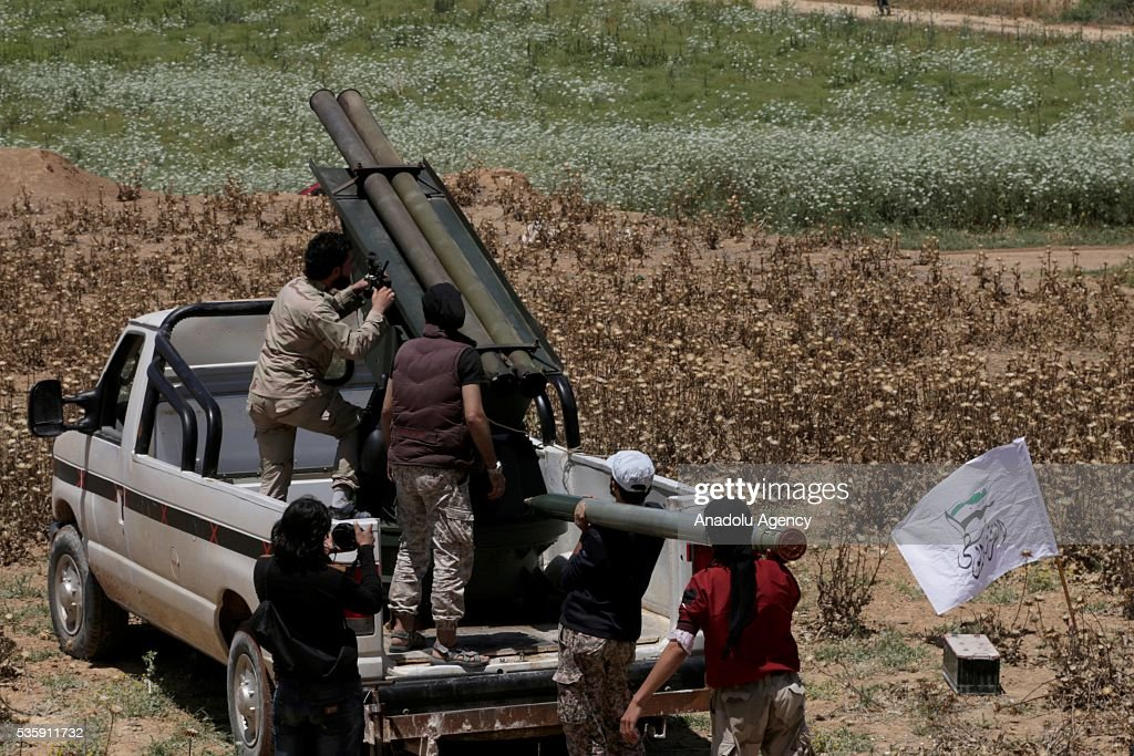 An opposition group's members make preparations in Hama, Syira on May 30, 2016 before they stage a missile attack against Assad Regime forces' Nahl checkpoint, located at the Sqailbiya town.